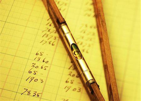 Close-Up of Level on Ledger Stock Photo - Premium Royalty-Free, Code: 600-00078184