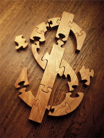strategy - Wooden Jigsaw Puzzle Forming Dollar Sign Stock Photo - Premium Royalty-Free, Code: 600-00070675