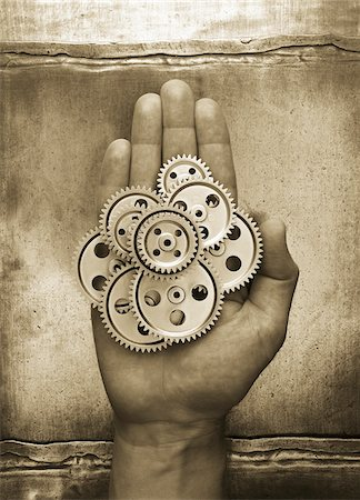 Gears in Palm of Hand Stock Photo - Premium Royalty-Free, Code: 600-00070672