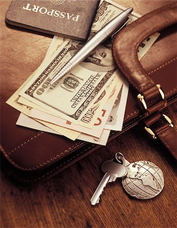 International Currency, Pen and Passport on Briefcase Stock Photo - Premium Royalty-Free, Code: 600-00072411