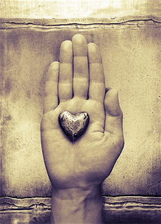 symbol - Heart in Palm of Hand Stock Photo - Premium Royalty-Free, Code: 600-00072464