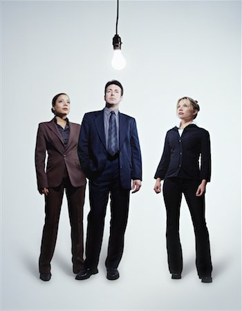 female white background full body - Three Business People Looking at Lightbulb Hanging from Ceiling Stock Photo - Premium Royalty-Free, Code: 600-00072810