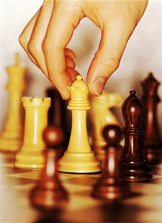 Hand Moving Chess Piece Stock Photo - Premium Royalty-Free, Code: 600-00085712