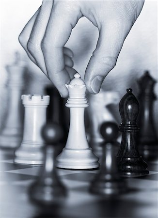 Hand Moving Chess Piece Stock Photo - Premium Royalty-Free, Code: 600-00085713