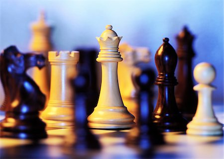 strategy - Close-Up of Chess Pieces on Board Stock Photo - Premium Royalty-Free, Code: 600-00086524
