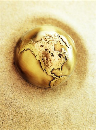 Metal Globe in Sand North America Stock Photo - Premium Royalty-Free, Code: 600-00155868