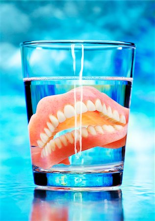 False Teeth in Glass Stock Photo - Premium Royalty-Free, Code: 600-00152984