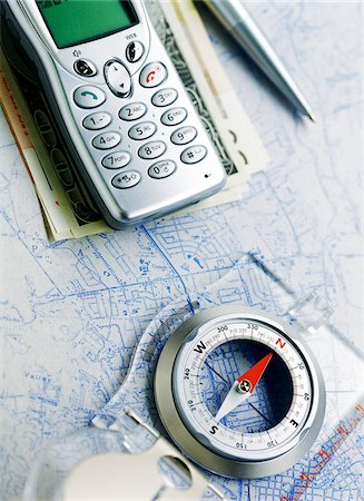 Cell Phone and Compass on Map Stock Photo - Premium Royalty-Free, Code: 600-00152987