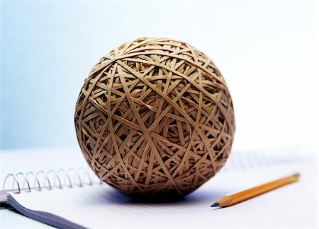 Rubber Band Ball, Pencil, and Notebook Stock Photo - Premium Royalty-Free, Code: 600-00165686