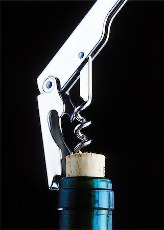 Corkscrew Opening Wine Bottle Stock Photo - Premium Royalty-Free, Code: 600-00168261