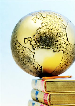 Close-Up of Globe on Books Stock Photo - Premium Royalty-Free, Code: 600-00177430