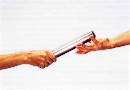 reaching - Hands Passing Baton Stock Photo - Premium Royalty-Free, Code: 600-00199209
