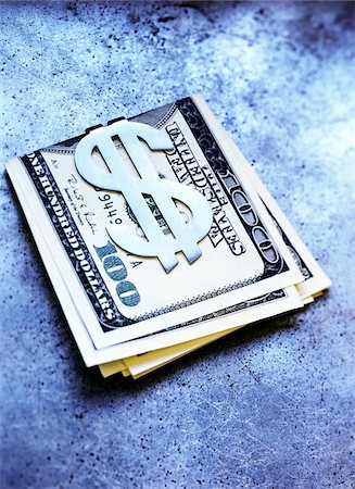 100 Dollar Bills in Money Clip Stock Photo - Premium Royalty-Free, Code: 600-00199215