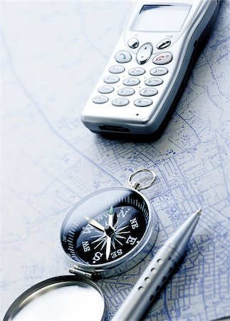 Compass, Cellular Phone Pen and Map Stock Photo - Premium Royalty-Free, Code: 600-00280873