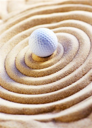 Golf Ball in Sand Stock Photo - Premium Royalty-Free, Code: 600-00280890