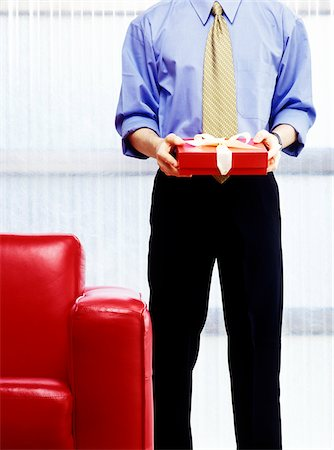 red chair - Businessman with a Gift Stock Photo - Premium Royalty-Free, Code: 600-00343143