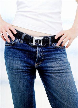 Woman Using Seatbelt as Belt Stock Photo - Premium Royalty-Free, Code: 600-00362039
