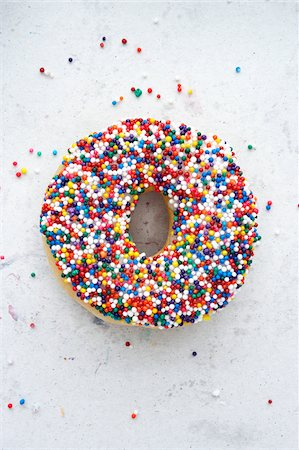 Sprinkle Doughnut Stock Photo - Premium Royalty-Free, Code: 600-00507147