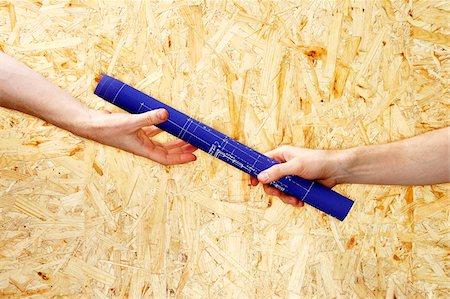 Hands Exchanging Blueprint-Baton Stock Photo - Premium Royalty-Free, Code: 600-00551102