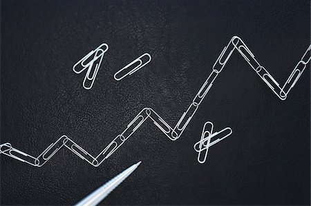Line Graph Made of Paper Clips Stock Photo - Premium Royalty-Free, Code: 600-00608294