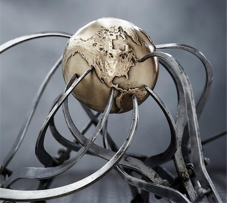 Calipers Gripping Steel Globe Stock Photo - Premium Royalty-Free, Code: 600-00608311