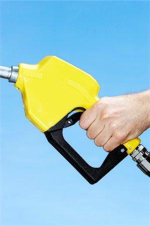 Hand Using Gas Pump Stock Photo - Premium Royalty-Free, Code: 600-00608326
