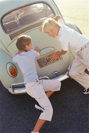 stalled car - Children Pushing Car Stock Photo - Premium Royalty-Free, Code: 600-00795573