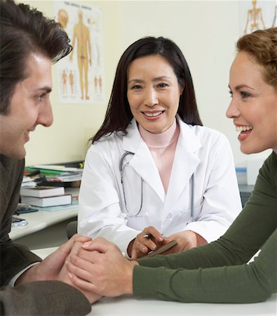 Doctor With Patients Stock Photo - Premium Royalty-Free, Code: 600-00795755