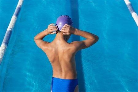 Portrait of Boy by Swimming Pool Stock Photo - Premium Royalty-Free, Code: 600-00814557