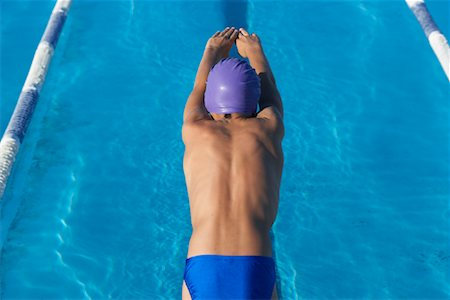 Boy Diving into Swimming Pool Stock Photo - Premium Royalty-Free, Code: 600-00814558
