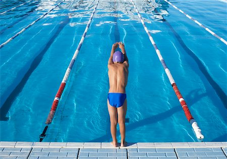 Boy Diving into Swimming Pool Stock Photo - Premium Royalty-Free, Code: 600-00814560
