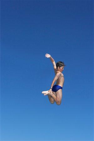 Boy Jumping Stock Photo - Premium Royalty-Free, Code: 600-00814655