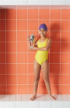 preteen girl feet - Portrait of Girl Holding Trophy Stock Photo - Premium Royalty-Free, Code: 600-00814700