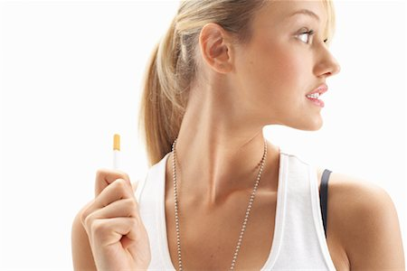 Girl Holding Cigarette Stock Photo - Premium Royalty-Free, Code: 600-00824014