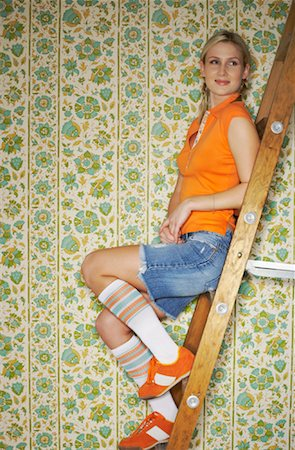 Woman Sitting on Ladder Stock Photo - Premium Royalty-Free, Code: 600-00824484