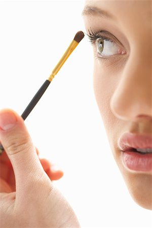 Girl Applying Make-up Stock Photo - Premium Royalty-Free, Code: 600-00823996
