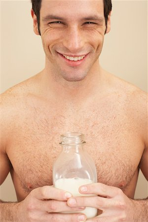 Man Holding Bottle of Milk Stock Photo - Premium Royalty-Free, Code: 600-00845955