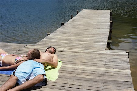 Couple Relaxing on Dock Stock Photo - Premium Royalty-Free, Code: 600-00846439