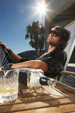 drunk passed out - Man Sitting on Patio Chair Stock Photo - Premium Royalty-Free, Code: 600-00848686