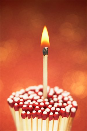 Lit Match with Cluster of Unlit Matches Stock Photo - Premium Royalty-Free, Code: 600-00865469