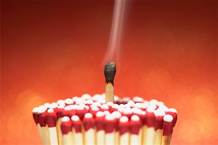 Burnt Match with Cluster of Unlit Matches Stock Photo - Premium Royalty-Free, Code: 600-00865470