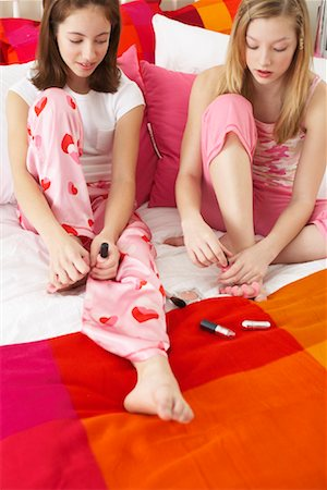 Girl's Painting Nails Stock Photo - Premium Royalty-Free, Code: 600-00866079