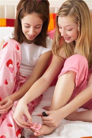 Girl's Painting Toe Nails Stock Photo - Premium Royalty-Free, Code: 600-00866085
