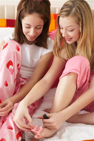 preteen girl feet - Girl's Painting Toe Nails Stock Photo - Premium Royalty-Free, Code: 600-00866085