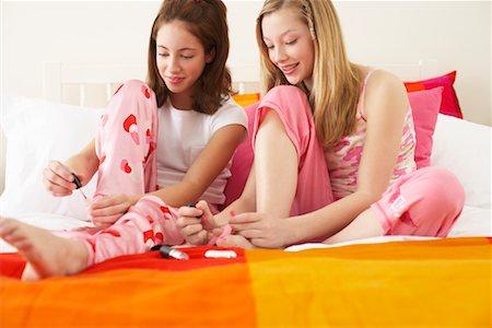 preteen girl feet - Girl's Painting Nails Stock Photo - Premium Royalty-Free, Code: 600-00866081