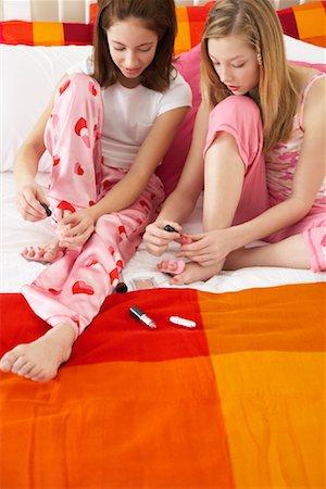 preteen girl feet - Girl's Painting Toe Nails Stock Photo - Premium Royalty-Free, Code: 600-00866083