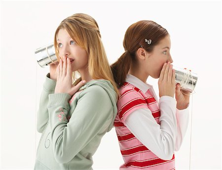 Girls Talking with Tin Can Telephones Stock Photo - Premium Royalty-Free, Code: 600-00866158