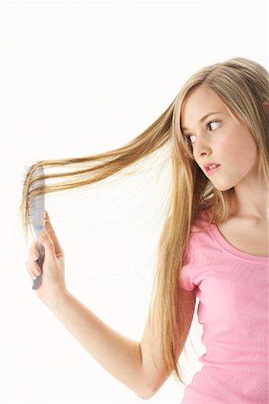Girl Brushing Hair Stock Photo - Premium Royalty-Free, Code: 600-00866219