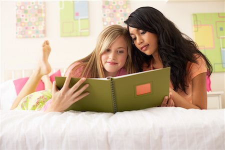 Girls Looking at Photo Album Stock Photo - Premium Royalty-Free, Code: 600-00866212