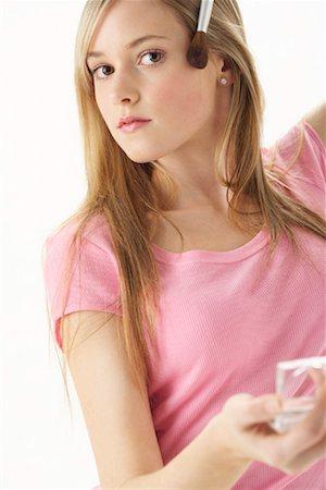 Girl Applying Make-Up Stock Photo - Premium Royalty-Free, Code: 600-00866227